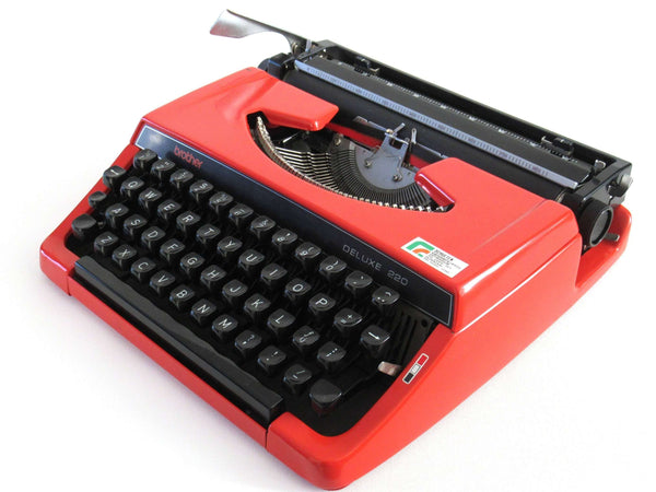UpperDutch:Typewriter,Brother Deluxe 220 working typewriter. Red metal body, two tone ink ribbon. Portable writing machine. Office decor QWERTY layout