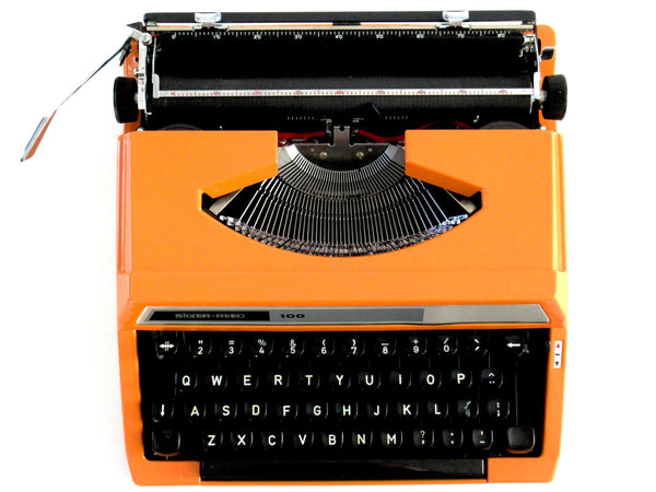 UpperDutch:Typewriter,Silver-Reed 100 working typewriter made in 1976. 1970's Orange typewriter, Silver Seiko Co Japanese QWERTY writing machine
