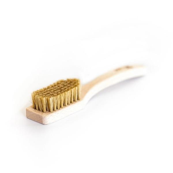 Lapis Uber bouldering Brush with wooden handle, shown laid flat on white surface
