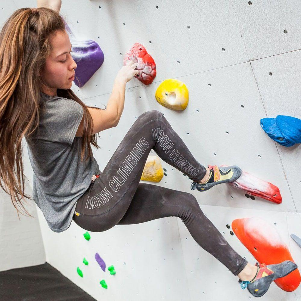 Moon Sigma Leggings Womens demonstarted in use on a woman climber indoors