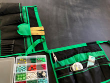 green and black bucket organizer shown flat with hobbies accessories for jewelry making
