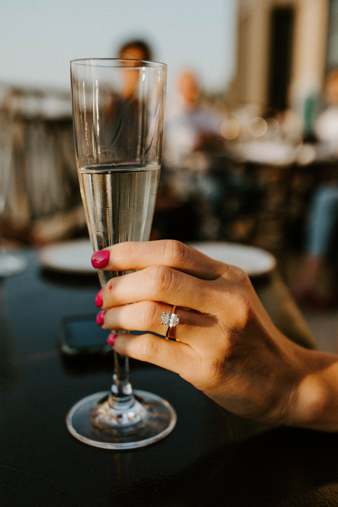 Champagne with oval engagement ring