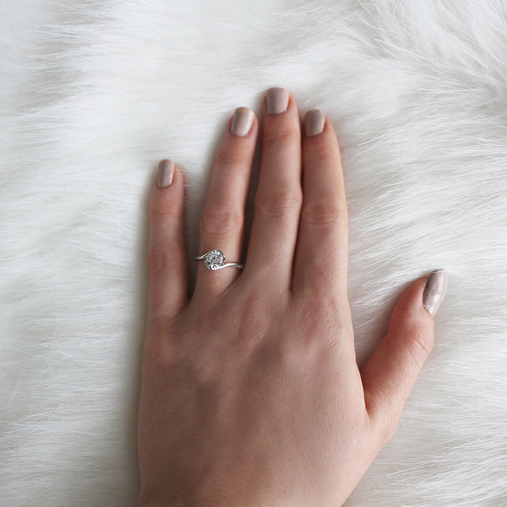 Bypass style engagement ring white gold