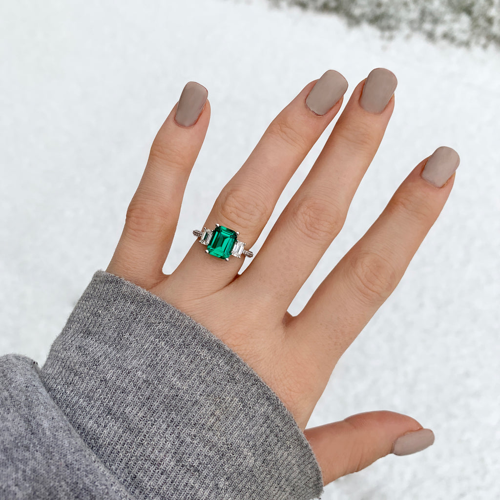 Emerald cut emerald three stone ring