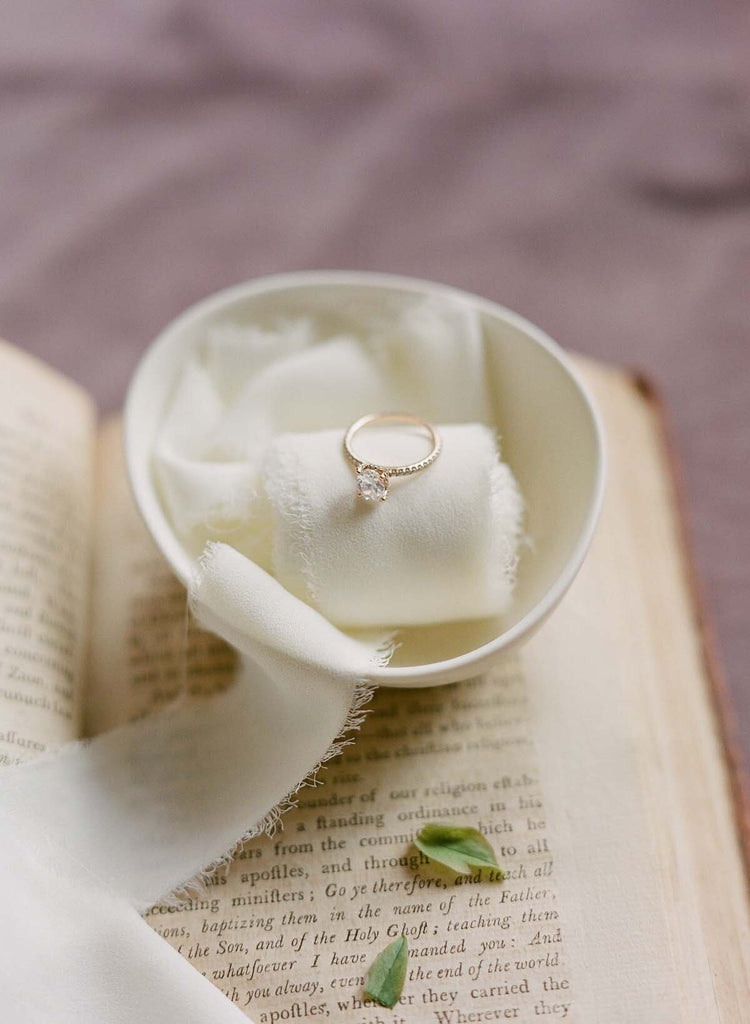 Engagement Ring in white bowl