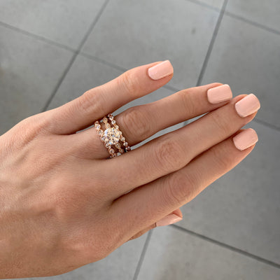 Rose gold solitaire engagement ring with scalloped band