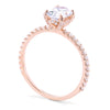 Rose gold oval engagement ring with diamonds on prongs