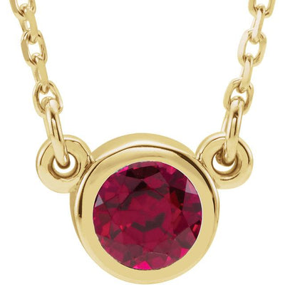Ruby bezel set yellow gold necklace