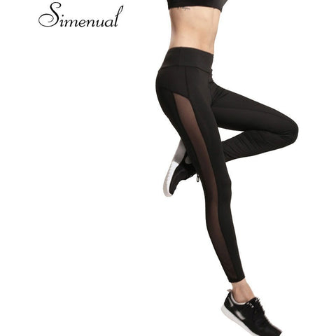 Women's slim, black leggings,  includes mesh spliced into sides - yoga, sports, leisure - S, M, L