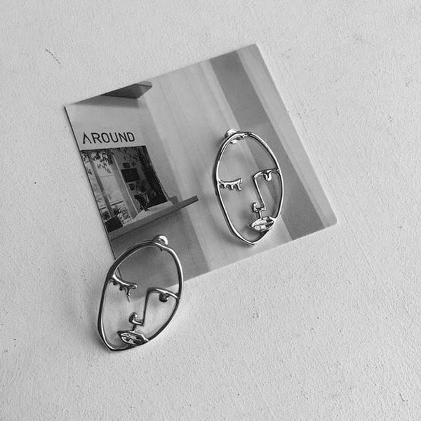 Unique personality exaggerated metal hollow out in the face of the human body stud earrings earrings profile women abstract