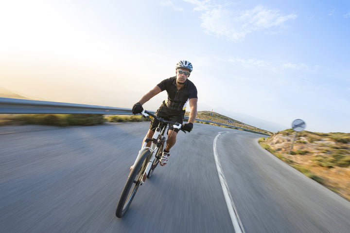 man with healthy skin cycling