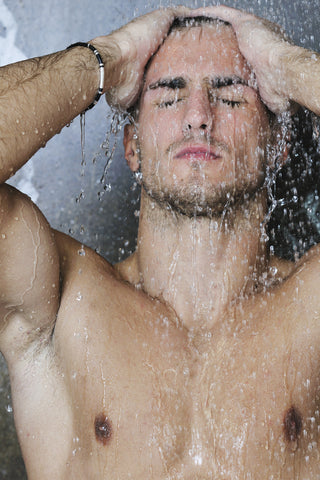 young good looking and attractive man with muscular body wet taking shower in morning