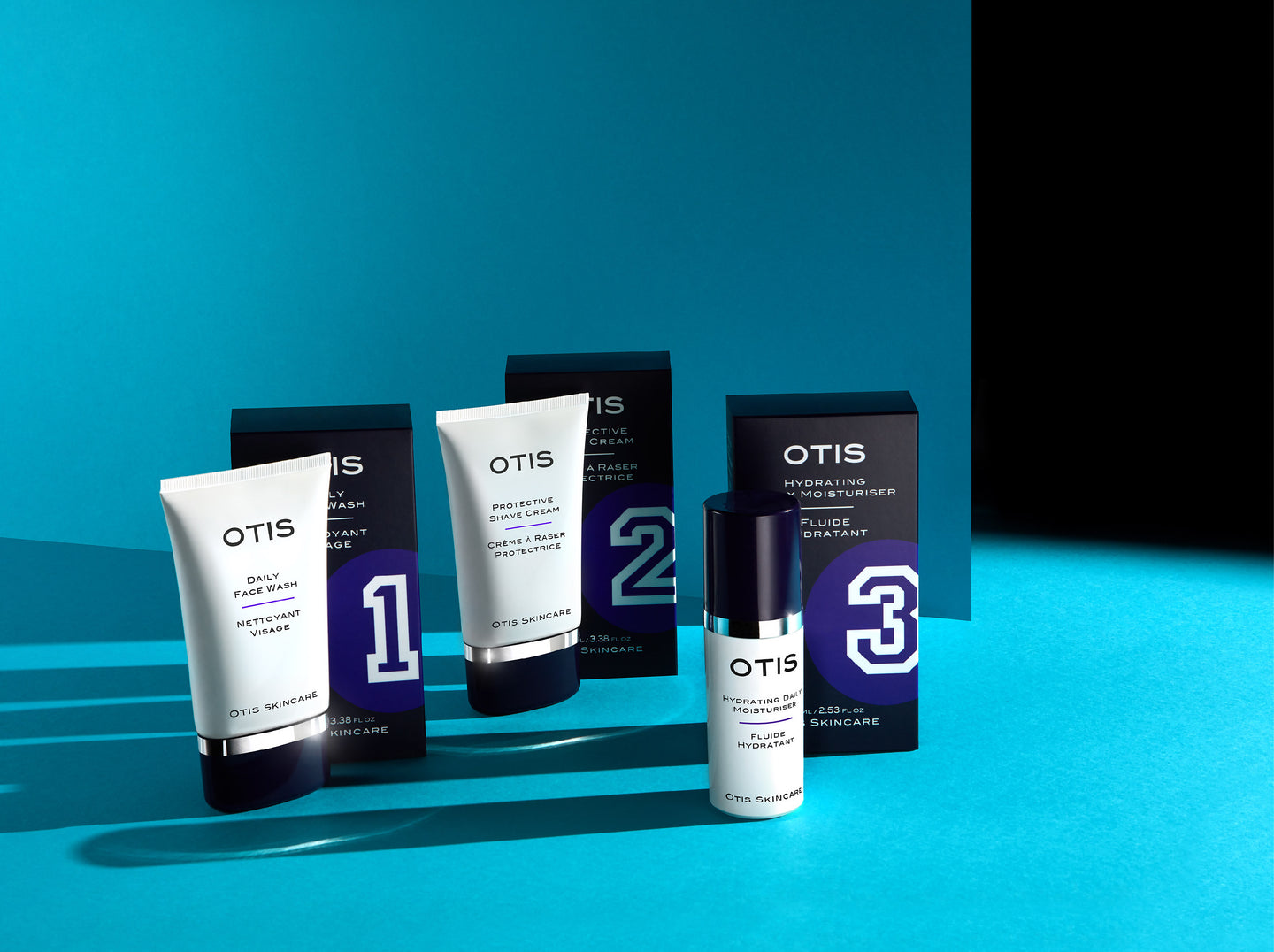 Otis Skincare - three skincare products for men. Packaging shown on a blue background.