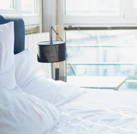 comfy pillows and duvet to help you sleep better