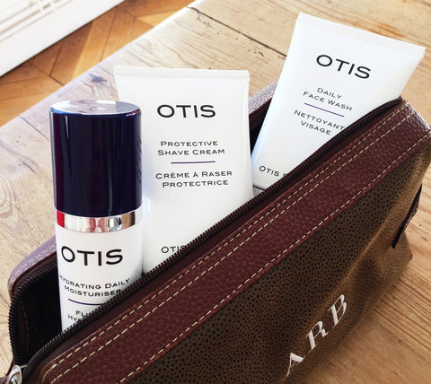 Otis Skincare products for men in a leather wash bag