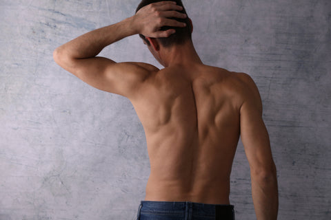Rear view of handsome muscular man. Male Waxing. Manscaping