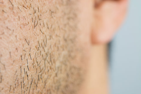 Close up of the direction of a man's facial hair