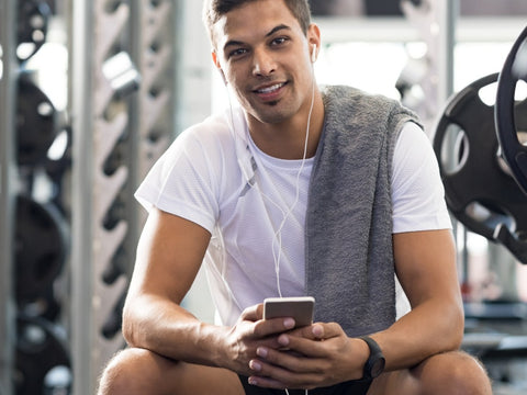 Healthy guy at the gym, smiling