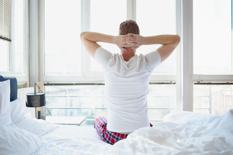 man waking up after sleeping better