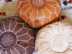 Three Leather Ottomans