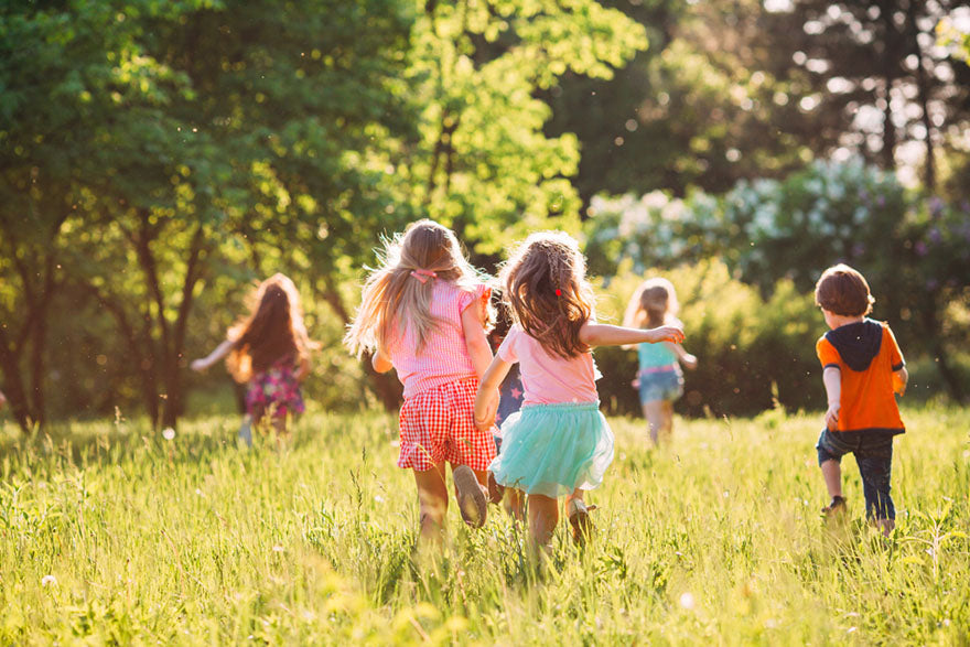 group of children play on summer day