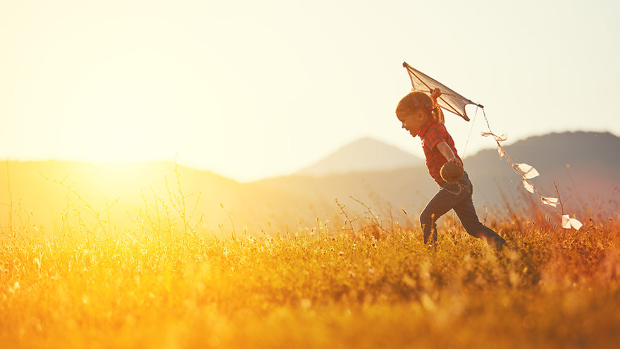 a child running with a kite