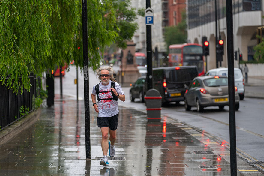 man jogging in bad weather