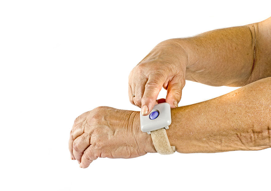a person pressing their emergency button bracelet