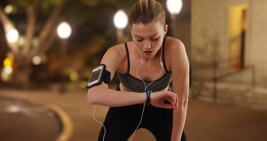 woman checking smart fitness device