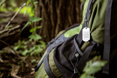 FIXX ID Dog Tag strapped to hiking pack