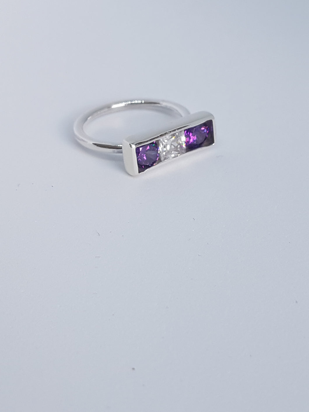 Sterling silver ring with purple& clear cubic zirconia