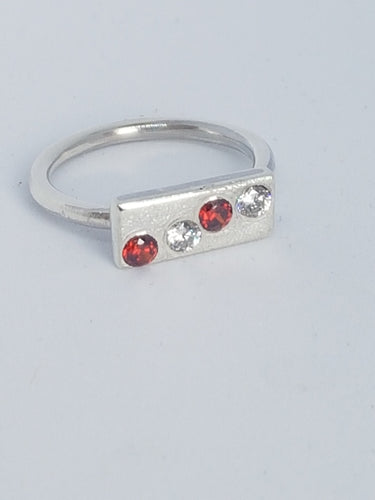 Sterling silver ring with red& clear cubic zirconia