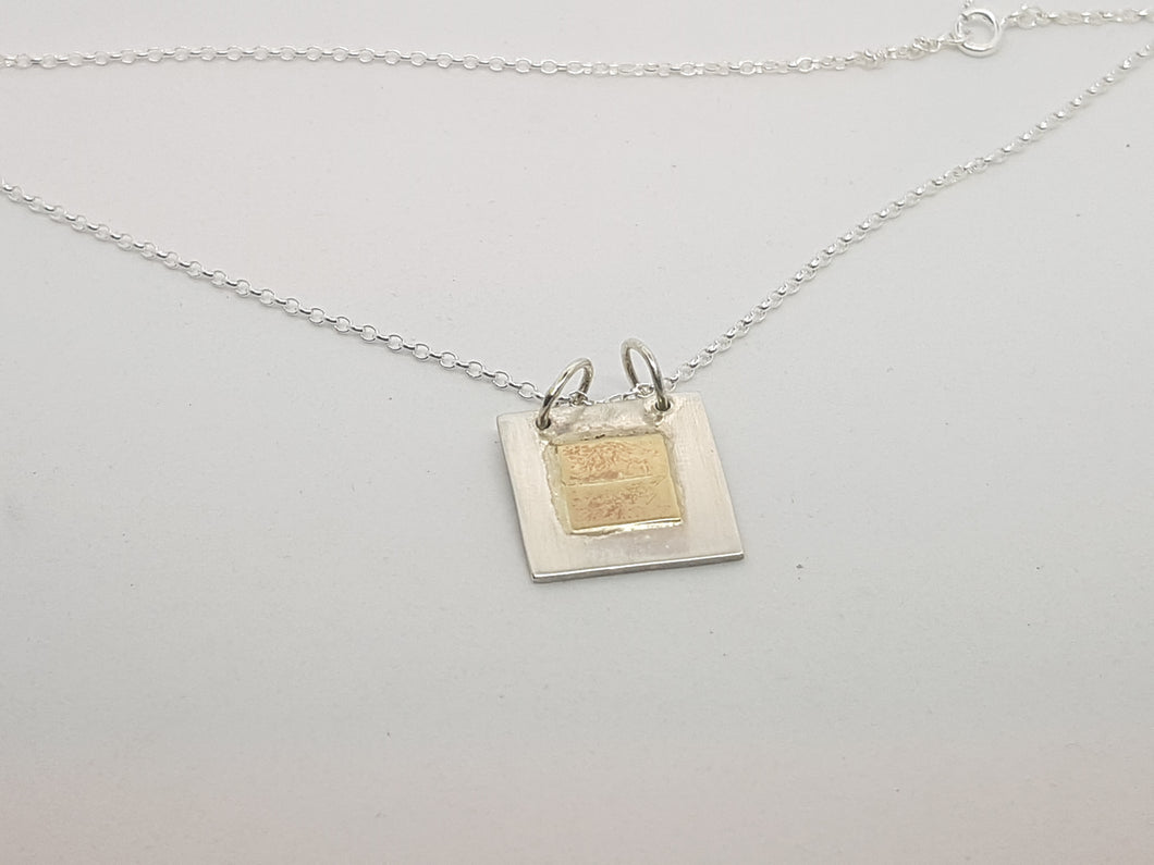 Sold!Sterling silver & 9ct gold square pendant