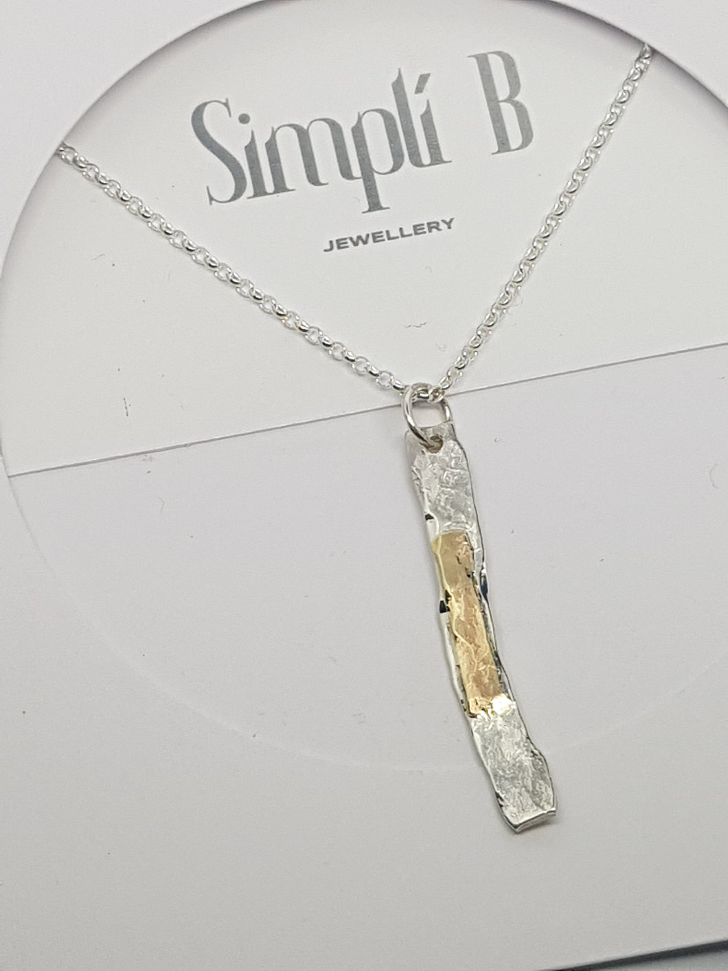 Sold!sterling silver & 9ct gold hammer textured pendant