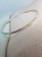 Sterling silver hammer textured bangle with 9ct gold accents