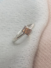 Sterling silver ring with a 9ct gold accent