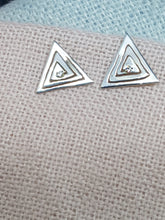 Sterling silver cut out triangle drop earrings set with a clear cubic zirconia