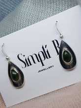 Sterling silver drop earrings set with Jade cabochon stones