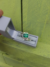 Sterling silver ring set with an emerald green cubic zirconia