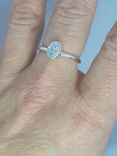 Sterling silver ring set with a clear cubic zirconia