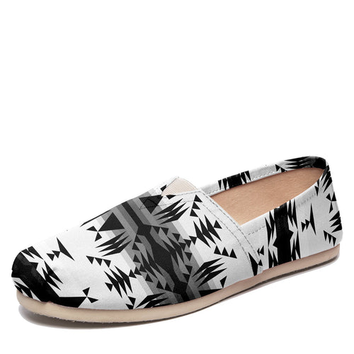 Between the Mountains White and Black Casual Unisex Slip On Shoe Herman