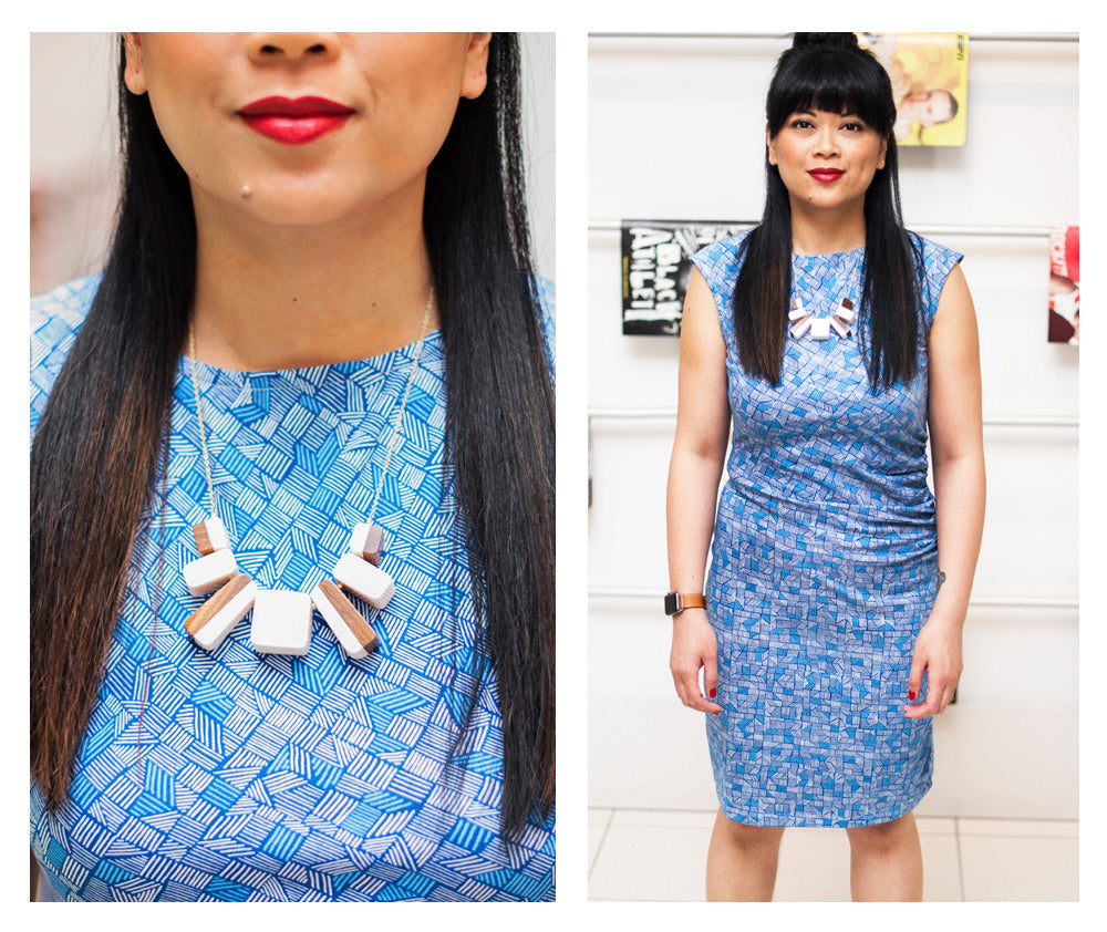 Bernadette wearing the First Impressions dress in blue lines and the Two Tone Block necklace in white.