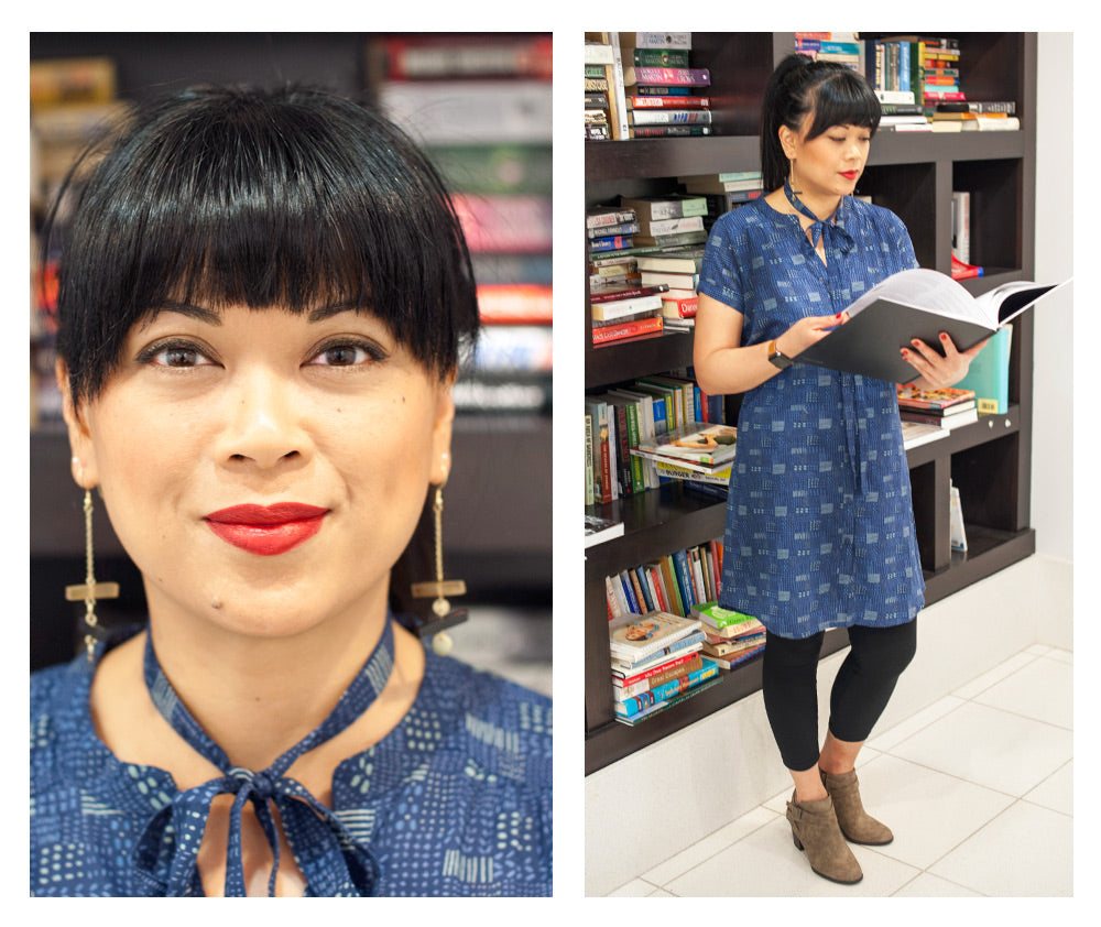 Bernadette wearing the Whidby Shirtdress in patchwork and the Raise the Bar earrings in gold.