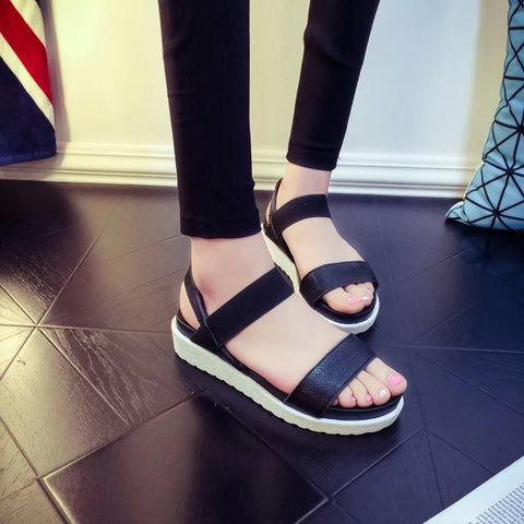 Sport-sexy peep-toe and flat roman sandals