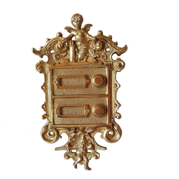 Double Button Door Bell With Cherub Motif In Polished Brass