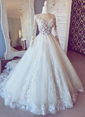 White lace long sleeve ball gown dress wedding dress