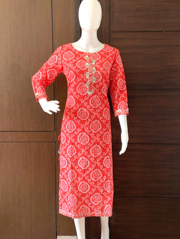 ORANGE COTTON BANDHINI PRINTED CASUAL WEAR KURTI