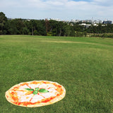 cheese pizza towel in a park