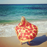 girl at beach with pepperoni pizza towel