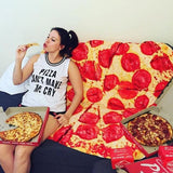 girl eating pizza on a pepperoni pizza towel